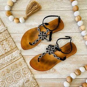 Mystique black jeweled ankle strap flat sandals